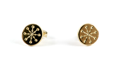 cufflinks: Isolated close up of golden cufflinks over white Stock Photo