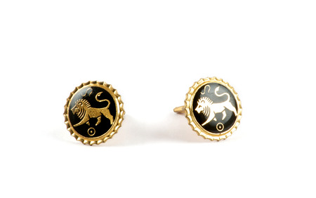 cufflinks: Isolated close up of golden cufflinks with lions over white