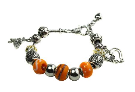 ornamentations: Pandora bracelet with orange beads isolated on white background Stock Photo