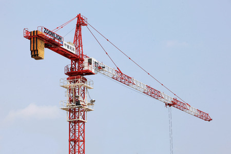 Red construction crane for heavy lifting
