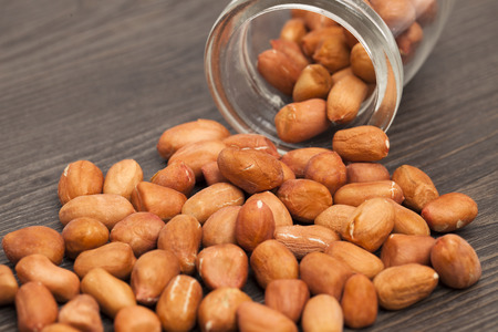 earthnuts: Peanuts on a wood color background
