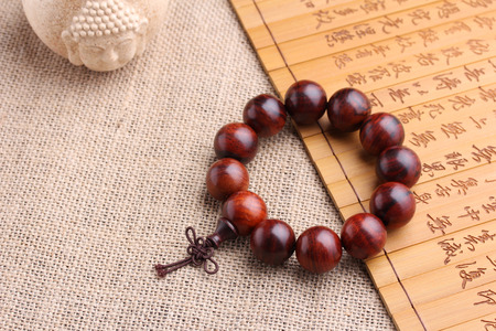 piety: Lobular red sandalwood prayer beads bracelets Stock Photo