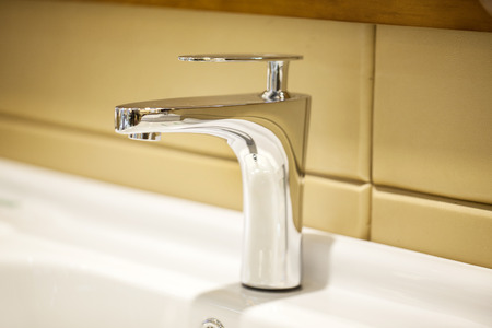 kitchensink: Closeup of water-supply faucet isolated in modern bathroom