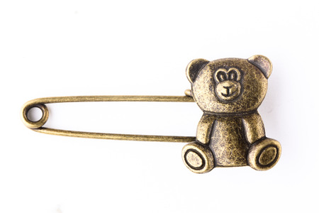diaper pins: One Bronze safety pin isolated on white background Stock Photo