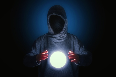 Fortune teller with magic crystal ball Stock Photo