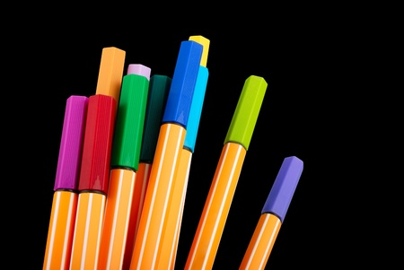 12 colourful highliter pens  isolated on black  photo