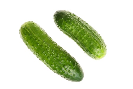 medium close up: Two green cucumbers  isolated on white