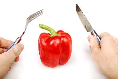 provisions: Red bulgarian pepper with knife and fork in hands