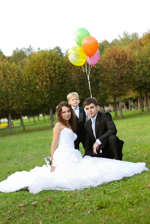 mother and father and son with balloons photo