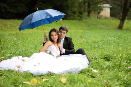2 persons only: young bride and the bridegroom in the park