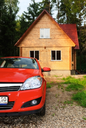 traditional house: Modern wooden Russian traditional house and the car of the red colour