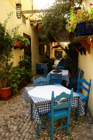 outdoor cafe: Outdoor cafe in old greek town