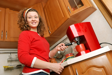 woman with red coffee machine photo