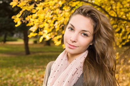 strolling: Gorgeous young brunette strolling in autumn park. Stock Photo