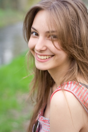 exuberant: Romantic portraits of young brunette outdoors at spring sitting relaxed. Stock Photo