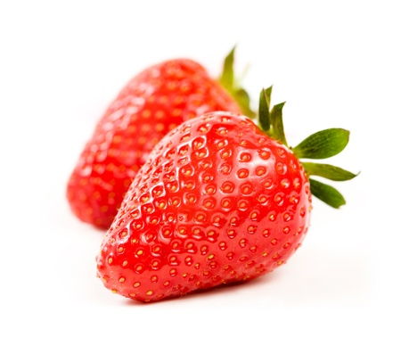 Macro shot of beautiful ripe and fesh strawberries isoltaed on white background.