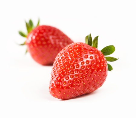 Macro shot of juicy fresh strawberries isoalted on white. Stock Photo - 9328611