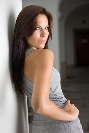 Portrait of a hot young brunette girl looking back over her shoulder. photo