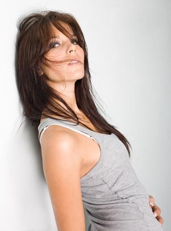 hottie: Brunette hottie posing for the camera, looking back. Stock Photo