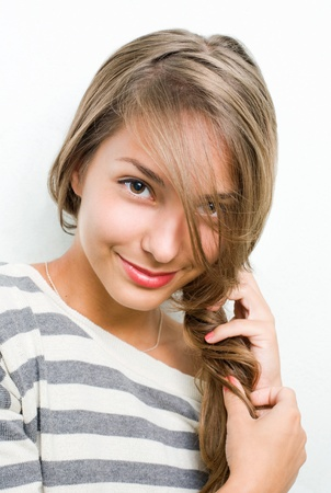 beauty shot: Beauty shot of tanned smiling young brunette girl.