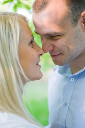 Attractive romantic young couple outdoors in nature, about to kiss. Stock Photo - 9410329