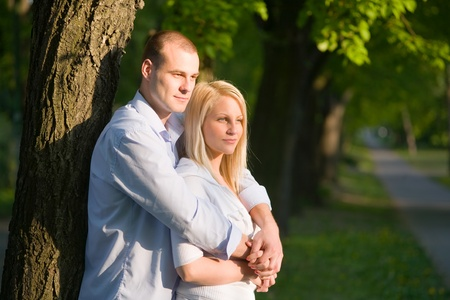 Attractive romantic couple in beautiful sunset light in the park. photo