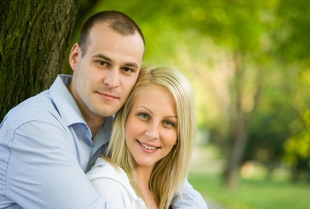Outdoors portrait of romantic fashionable young couple. photo