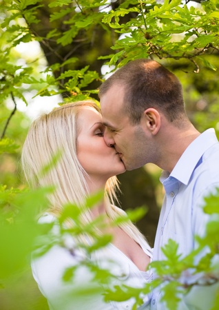 Romantic young couple kissing. photo