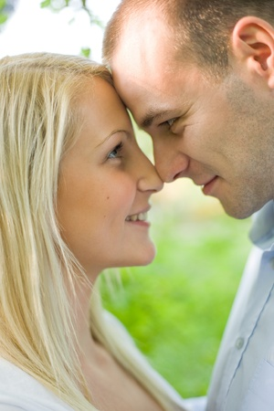 Outdoors portrait of romancing young couple. photo