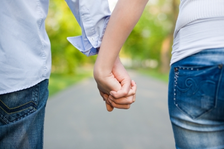 couple holding hands: Closeup shot of young couple holding hands.  Stock Photo