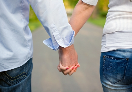 Closeup shot of young couple holding hands.  Stock Photo - 9420262