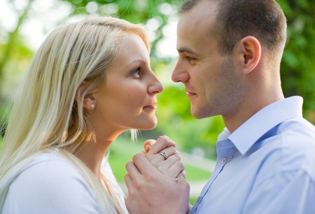 Attractive young couple romancing in the park at sunset. Stock Photo - 9420237