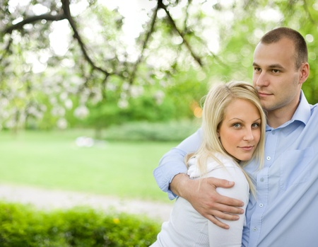 heterosexual couples: Romantic portrait of attractive young couple out doors in nature. Stock Photo
