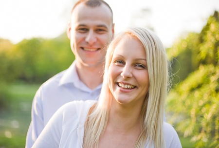 Fresh bright portrait of young couple outdoors at dusk. Stock Photo - 9420026