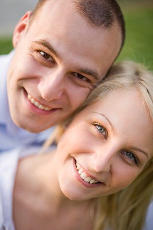 Closeup outdoors portrait of happy young smiling couple. photo