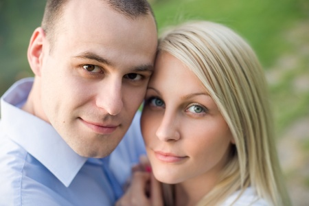 Closeup portrait of attractive young couple having fun outdoors- photo