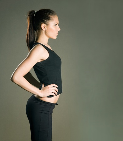 Gorgeous young slender fitness girl posing. Stock Photo - 9454451