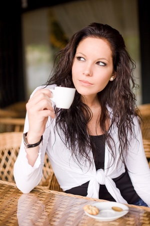 Beautiful brunette girl having a coffee. photo