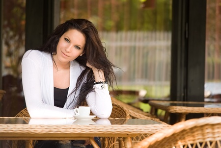 Gorgeous young brunette hanging out at the coffee shop. photo