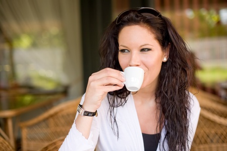 Gorgeous young brunette hanging out at the coffee shop. Stock Photo