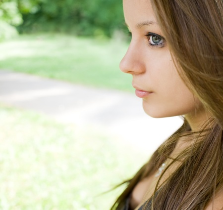 Profile portrait of cute young teen girl wiuth copy space. Stock Photo - 9680611