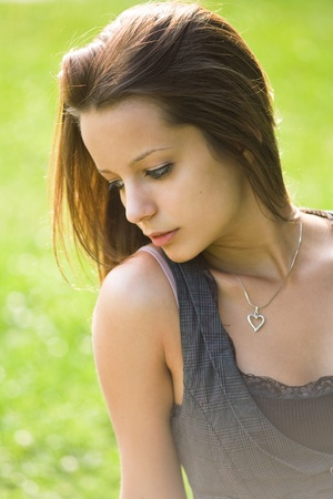 Romantic portrait of beautiful young brnuette girl outdoors. Stock Photo - 9680626