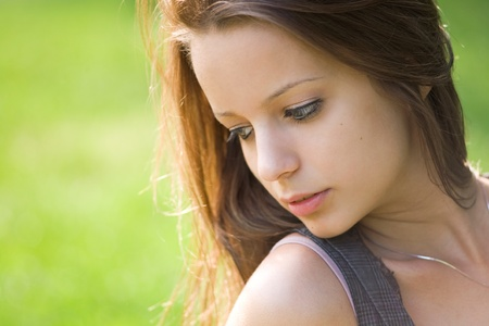 Romantic portrait of beautiful young brnuette girl outdoors. Stock Photo - 9680612