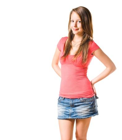minijupe: Portrait de studio de belle fille brune isol� sur fond blanc.