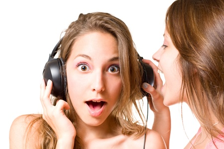 Share your music, brunette girl shouting to one wearing headphones, shocked expression. photo