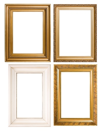 An assortment of empty classic vintage picture frames isolatedon white background.