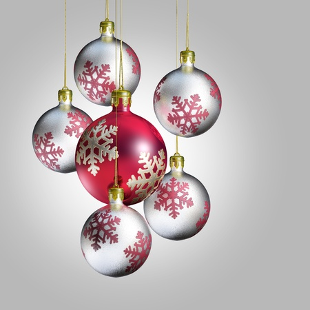 Shiny pink and silver christmas baubles on gray background. photo