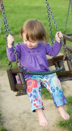 Young toddler baby girl playing in the playground. photo