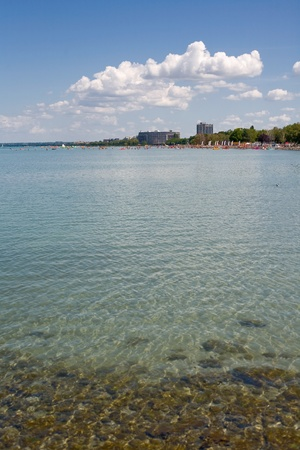 bathers: distant view of summer beach resort on lake balaton