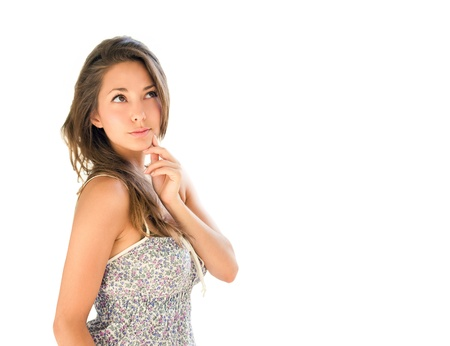 questioning: Beautiful young brunette isolated on white background, pondering, thinking about...